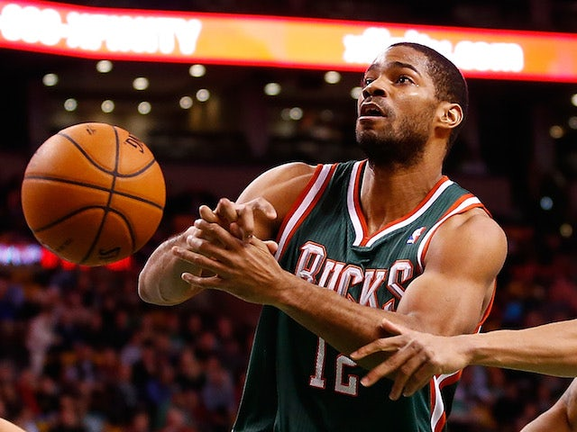Gary Neal of the Milwaukee Bucks has the ball stripped from him by Courtney Lee of the Boston Celtics in the second half during the game at TD Garden on December 3, 2013