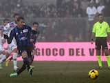 Atalanta's German Denis scores his team's first goal via the penalty spot against Calcio Catania during their Serie A match on January 12, 2014
