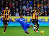 Ashley Cole of Chelsea tackles Yannick Sagbo of Hull City during the Barclays Premier League match between Hull City and Chelsea at KC Stadium on January 11, 2014