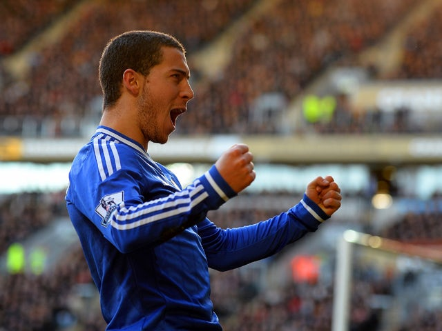 Eden Hazard of Chelsea celebrates scoring their first goal during the Barclays Premier League match between Hull City and Chelsea at KC Stadium on January 11, 2014