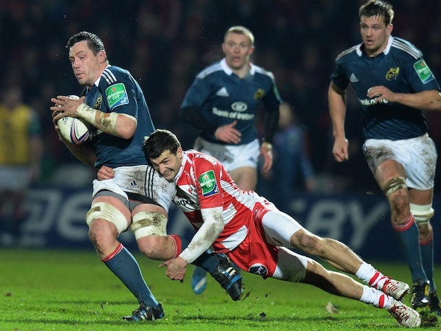 Jonny May of Gloucester tackles James Coughlan of Munster during the Heineken Cup Pool Six match between Gloucester and Munster at Kingsholm Stadium on January 11, 2014