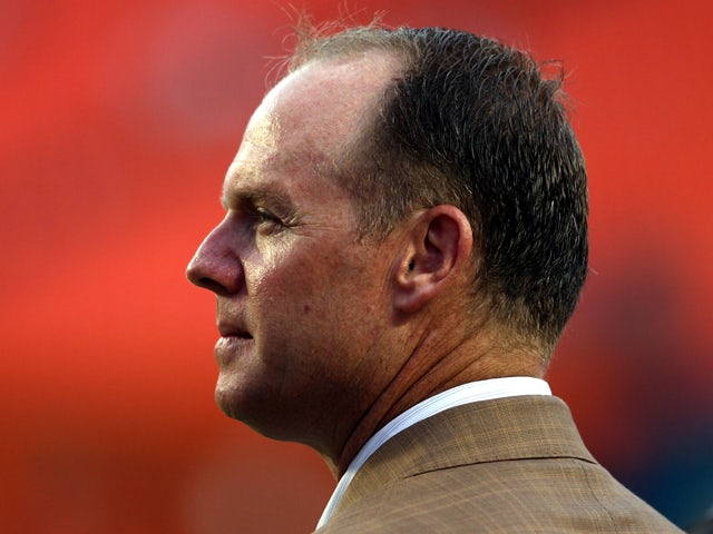 General Manager Jeff Ireland of the Miami Dolphins watches prior to his team playing against the Tampa Bay Buccaneers at Sun Life Stadium on August 24, 2013