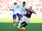 Fiorentina's Joaquin Sancez Rodriguez and Torino's Alexander Farnerud in action during their Serie A match on January 12, 2014