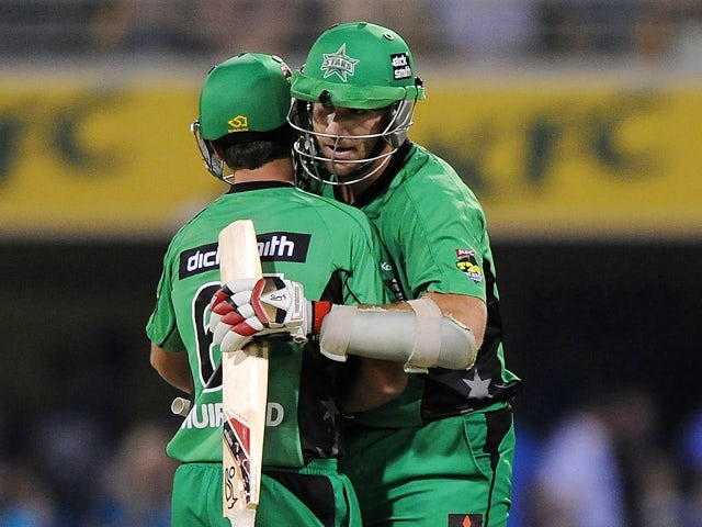 John Hastings of the Stars celebrates victory with James Muirhead during the Big Bash League match between Brisbane Heat and the Melbourne Stars at The Gabba on January 11, 2014