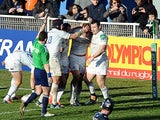 Leinster's Jordi Morphy is congratulated by teammates after scoring a try against Castres during their Heineken Cup match on January 12, 2014