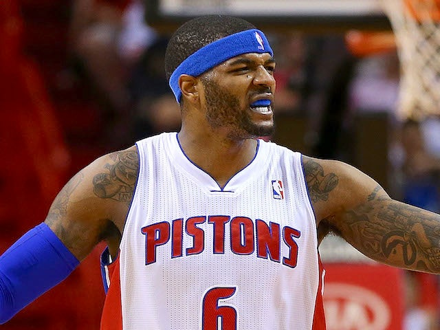 Josh Smith of the Detroit Pistons reacts to a play during a game against the Miami Heat at American Airlines Arena on December 3, 2013