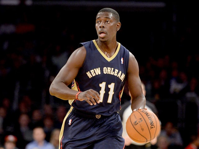 Jrue Holiday #11 of the New Orleans Pelicans brings the ball up court during the game against the Los Angeles Lakers at Staples Center on November 12, 2013