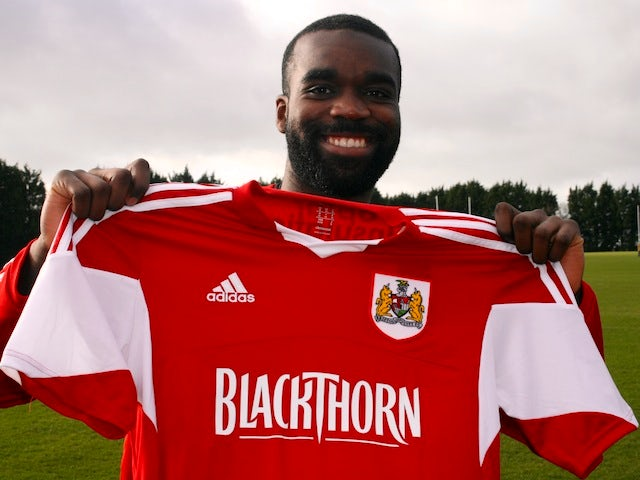 Karleigh Osborne poses with a Bristol City shirt after signing for the Robins on January 7, 2014