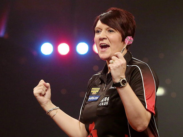 Lisa Ashton celebrates her win in the final over Deta Hedman during the BDO Lakeside World Professional Darts Championships on January 11, 2014
