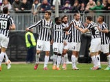 Juventus' Llorente is congratulated by teammates after scoring his team's first goal against Cagliari during their Serie A match on January 12, 2014