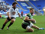 Tom Fowlie of London Irish goes over to score a try during the Amlin Challenge Cup match between London Irish and Lusitanos XV at Madejski Stadium on January 11, 2014