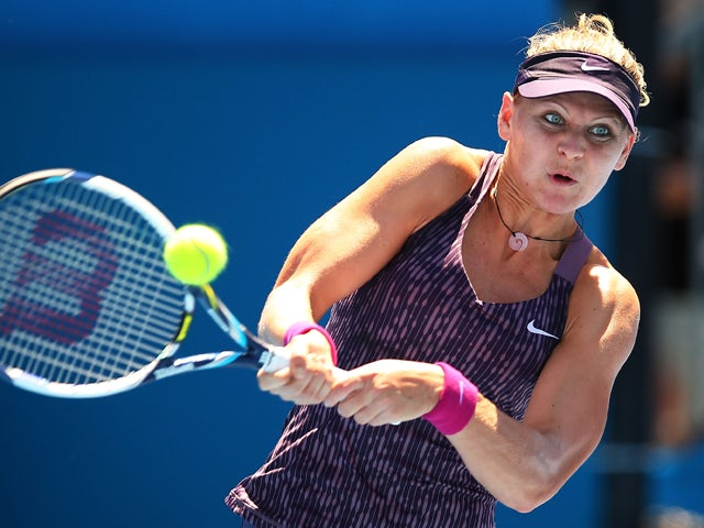 Lucie Safarova of the Czech Republic plays a backhand in her first round match against Francesca Schiavone of Italy during day two of the Sydney International at Sydney Olympic Park Tennis Centre on January 6, 2014