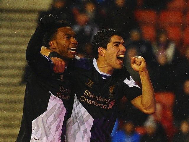 Liverpool's Luis Suarez celebrates with teammate Daniel Sturridge after scoring his team's fourth goal against Stoke during their Premier League match on January 12, 2014