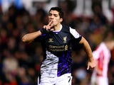 Liverpool's Luis Suarez celebrates after scoring his team's second goal against Stoke during their Premier League match on January 12, 2014