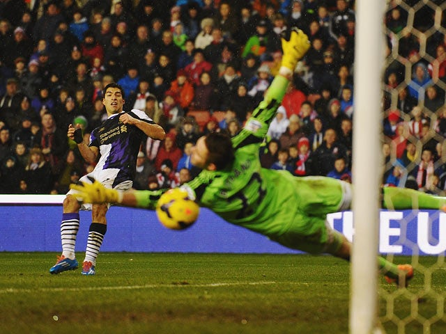 Liverpool's Luis Suarez scores his team's fourth goal against Stoke during their Premier League match on January 12, 2014