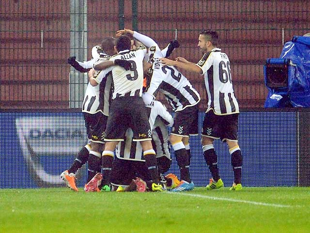 Udinese's Maicosuel is congratulated by teammates after scoring the opening goal against Inter Milan during their TIM Cup match on January 9, 2014