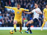 Marouane Chamakh of Crystal Palace holds off Nabil Bentaleb of Tottenham Hotspur during the Barclays Premier League match on January 11, 2014