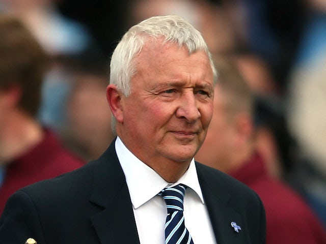 Mike Summerbee brings out the Barclays Premier League trophy following the Barclays Premier League match between Manchester City and QPR on May 13, 2012