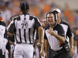 Cincinnati Bengals defensive coordinator Mike Zimmer argues with head linesman Kent Payne #79 during an NFL preseason game against the Indianapolis Colts at Paul Brown Stadium on September 1, 2011