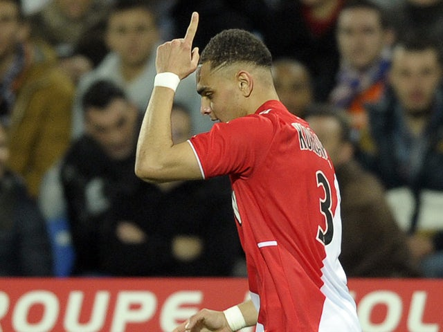 Monaco's French defender Layvin Kurzawa reacts after scoring a goal during the French L1 football match Montpellier vs Monaco at Mosson stadium in Montpellier, southern France, on January 10, 2013