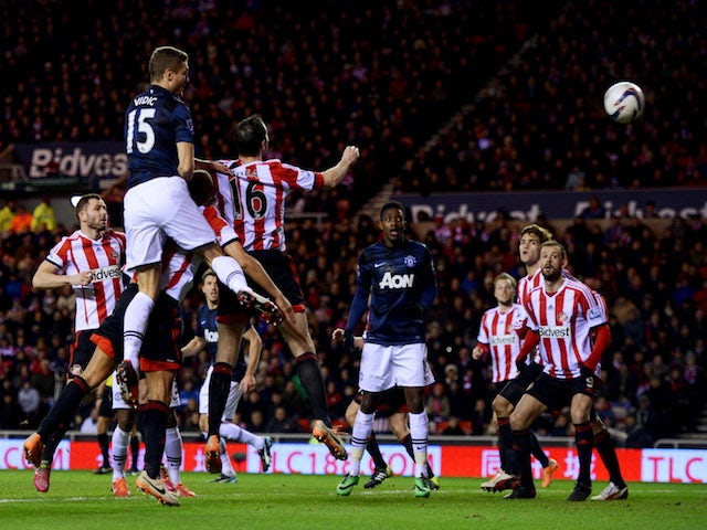 Nemanja Vidic of Manchester United scores their first goal with a header during the Capital One Cup Semi-Final, first leg match against Sunderland on January 7, 2014