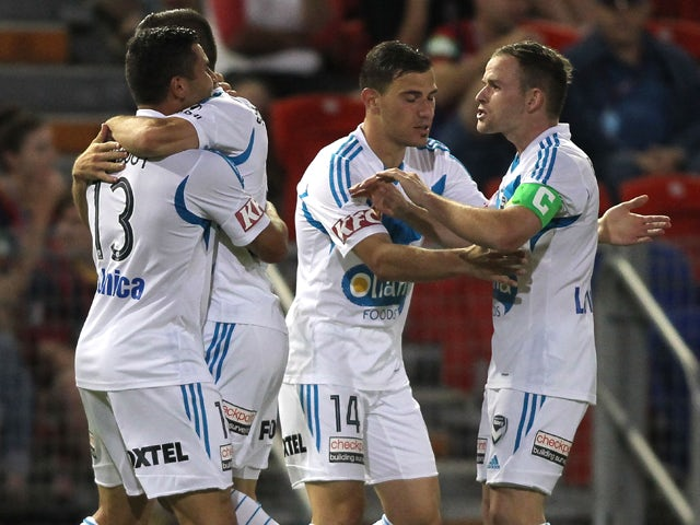 Victory players celebrate a goal during the round 14 A-League match between the Newcastle Jets and Melbourne Victory at Hunter Stadium on January 10, 2014
