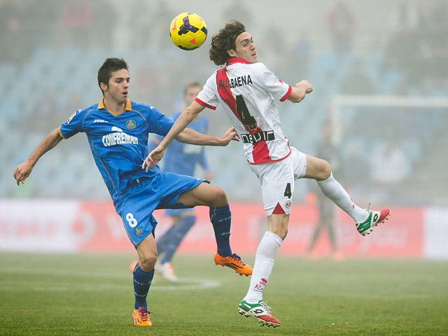Getafe's Pablo Sarabia and Rayo Vallecano's Raul Baena in action during their La Liga match on January 12, 2014