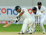Pakistan batsman Sarfraz Ahmed plays a shot as Sri Lankan wicketkeeper Prasanna Jayawardene looks on during the fourth day of the second cricket Test match between Pakistan and Sri Lanka at the Dubai International Cricket Stadium in Dubai on January 11, 2