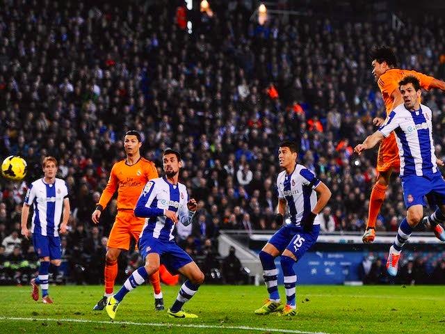 Pepe of Real Madrid CF scores the opening goal during the La Liga match between RCD Espanyol and Real Madrid CF at Cornella-El Prat Stadium on January 12, 2014