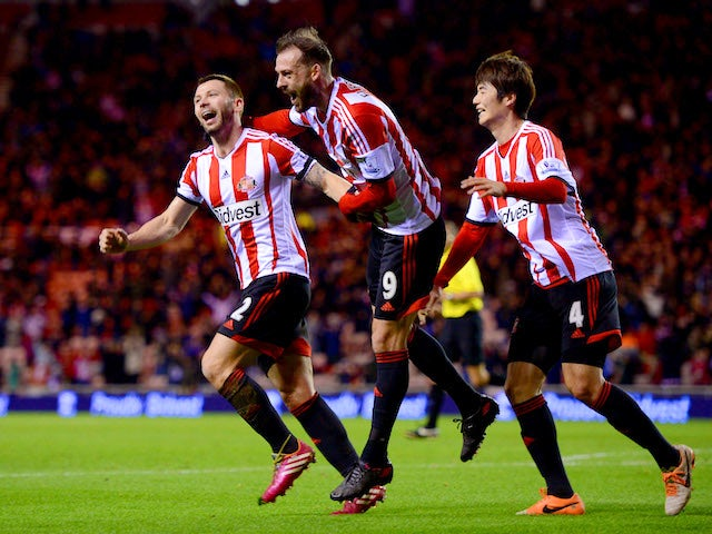Phil Bardsley of Sunderland celebrates with team mates Steven Fletcher and Ki Sung-Yong after Manchester United's Ryan Giggs scores an own goal on January 7, 2014
