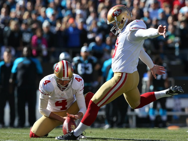 Phil Dawson of the San Francisco 49ers kicks a field goal in the first quarter against the Carolina Panthers on January 12, 2014