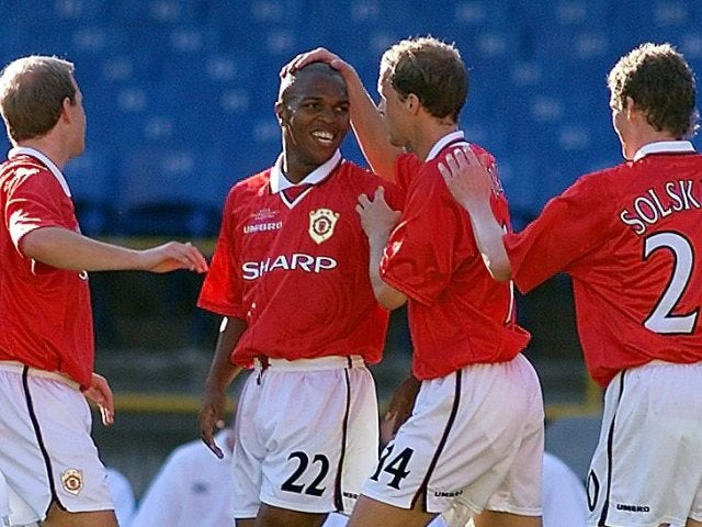 Quinton Fortune celebrates with his Manchester United teammates after scoring against South Melbourne on January 11, 2000.