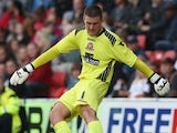 Richard O'Donnell of Walsall kicks the ball upfield during the pre season friendly match between Walsall and Aston Villa at the Banks' Stadium on July 31, 2013