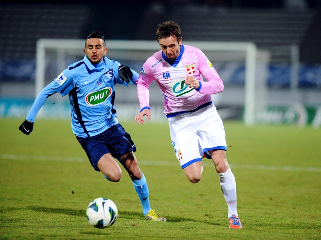 Evian's Swiss defender Fabrice Ehret vies with Le Havre's French forward Riyad Mahrez during their French Cup football match Evian (ETGFC) vs Le Havre (HAC) on February 26, 2013