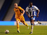 Rohan Ince of Brighton is challenged by Lee Minshull of Newport during the Capital One Cup First Round match between Brighton & Hove Albion and Newport County at Amex Stadium on August 6, 2013