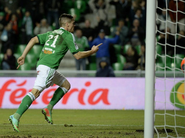 St Etienne's French midfielder Romain Hamouma reacts after scoring during the French Ligue 1 football match between Saint-Etienne (ASSE) and Evian TG on January 8, 2014