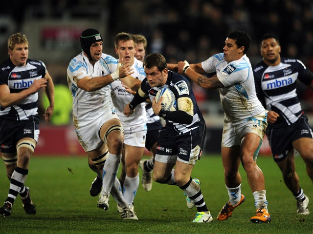 Mark Cueto of Sale Sharks breaks through the challenge of Josh Matavesi of Worcester Warriors during the Amlin Challenge Cup match between Sale Sharks and Worcester Warriors at the AJ Bell Stadium on January 10, 2014
