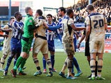 Chris Kirkland of Sheffield Wednesday breaks up a fight, after Matt Smith of Leeds United challenge on Reda Johnson of Sheffield Wednesday during the Sky Bet Championship match between Sheffield Wednesday and Leeds United at Hillsborough Stadium on Januar