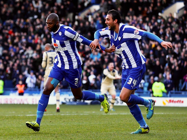 Reda Johnson of Sheffield Wednesday celebrates his goal with Atdhe Nuhiu during the Sky Bet Championship match between Sheffield Wednesday and Leeds United at Hillsborough Stadium on January 11, 2014