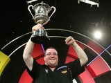 Stephen Bunting of England celebrates with the trophy after winning the final against Alan Norris of England during the BDO Lakeside World Professional Darts Championship on January 12, 2014
