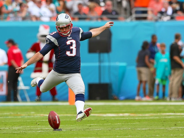Stephen Gostkowski #3 of the New England Patriots kicks off during a game against the Miami Dolphins at Sun Life Stadium on December 15, 2013