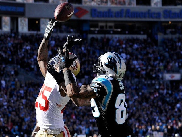 Steve Smith of the Carolina Panthers catches a touchdown against Tarell Brown of the San Francisco 49ers in the second quarter during the NFC Divisional Playoff game on January 12, 2014