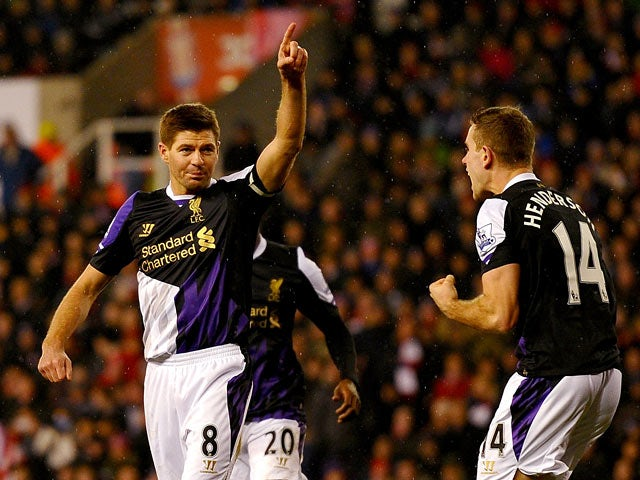 Liverpool's Steven Gerrard celebrates after scoring his team's third goal against Stoke during their Premier League match on January 12, 2014