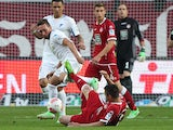Hoffenheim's Tobias Weis and Kaiserslautern's Ariel Borysiuk vie for the ball during the German first and second Bundesliga Relegation football match 1. FC Kaiserslautern vs. TSG 1899 Hoffenheim in Kaiserslautern, Germany, on May 27, 2013