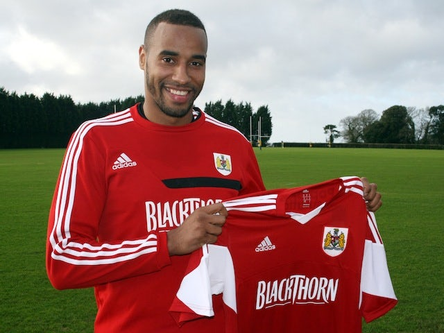 Tyrone Barnett poses with a Bristol City shirt after signing on loan for the Robins on January 8, 2014