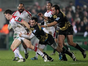 Montpellier's French centre Thomas Combezou tackles Ulster's Irish wing Craig Gilroy during the European Cup rugby union match between Ulster and Montpellier at Ravenhill Stadium in Belfast, Northern Ireland on January 10, 2014