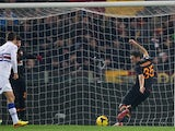 Roma's Vasilis Torosidis scores the opening goal against Sampdoria during their TIM Cup match on January 9, 2014