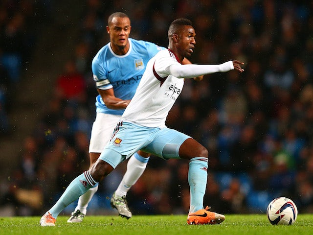 Vincent Kompany of Manchester City marks Modibo Maiga of West Ham during the Capital One Cup Semi-Final first leg match between Manchester City and West Ham United on January 8, 2014