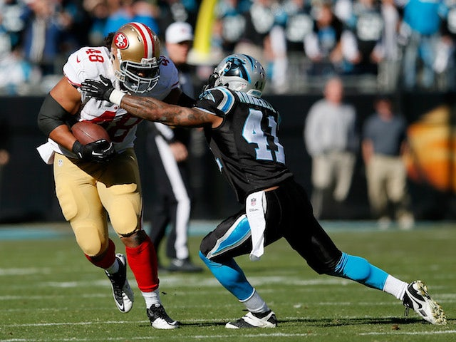 Will Tukuafu #48 of the San Francisco 49ers runs with the ball against Captain Munnerlyn #41 of the Carolina Panthers in the first quarter during the NFC Divisional Playoff game on January 12, 2014