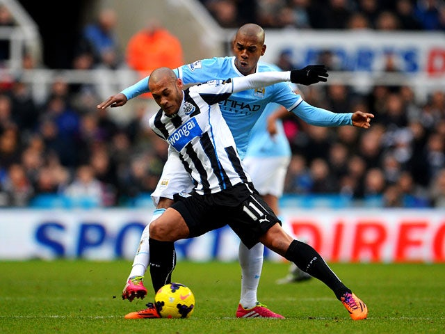 Newcastle's Yoan Gouffran and Manchester City's Fernandinho in action during their Premier League match on January 12, 2014